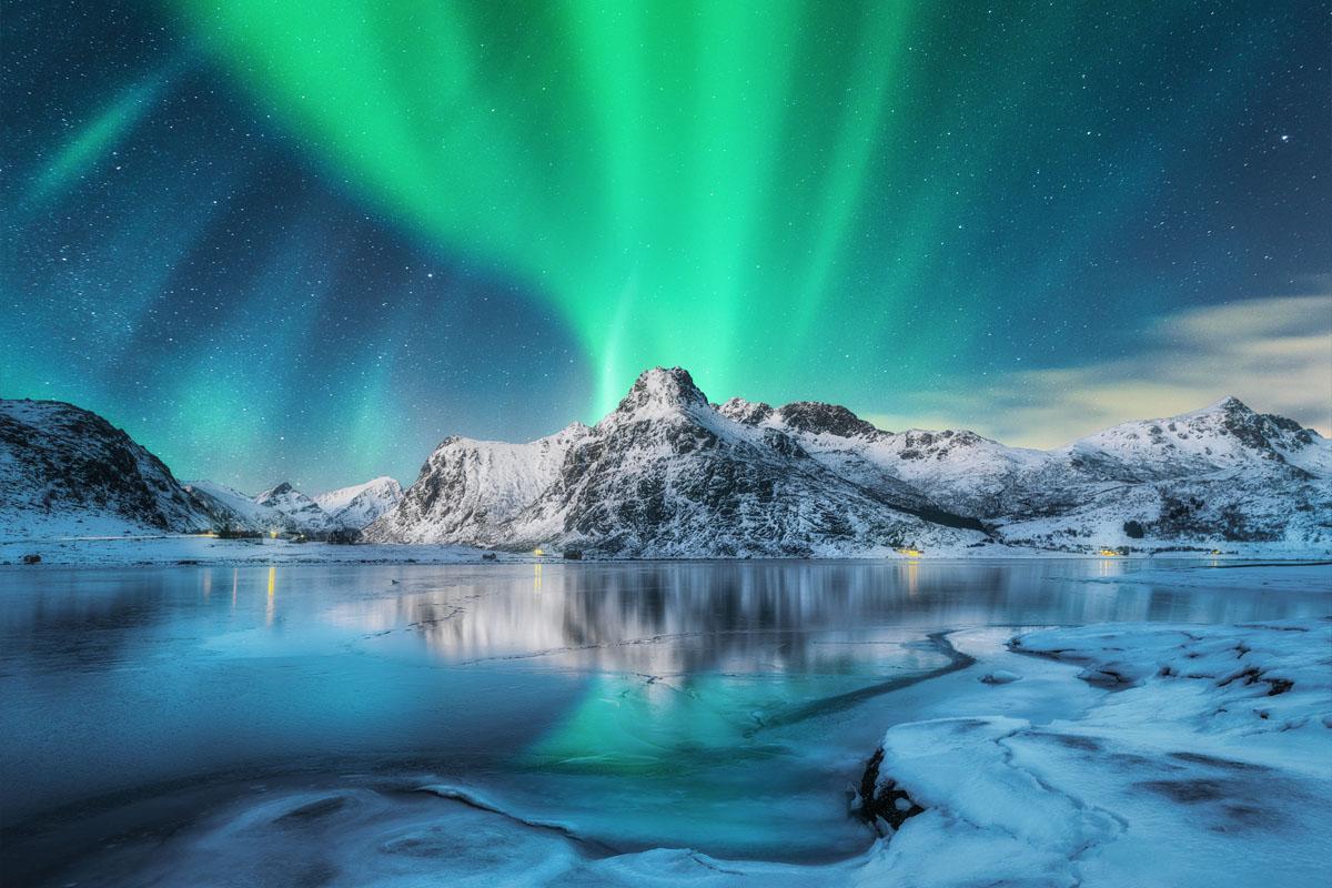 Aurora borealis on beach, Norway - lofoten photography workshop
